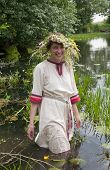 pic of undine  - girl in russian traditional clothes against river - JPG