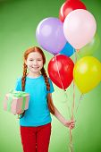 Pretty girl with giftbox and balloons looking at camera in isolation