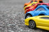 picture of speeding car  - miniature colorful cars standing in line on road sale concept - JPG