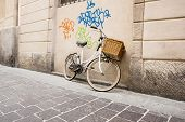 Retro bike and graffiti on wall.