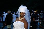 Jab Jab wedding guest in white