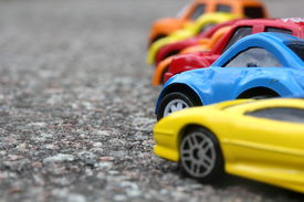 pic of color wheel  - miniature colorful cars standing in line on road sale concept - JPG