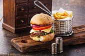 foto of wooden basket  - Burger With Meat And French Fries In Basket On Wooden Background - JPG