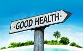 Good Health sign with a beach on background
