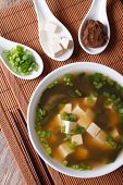 Miso Soup In A White Bowl And Ingredients Vertical Top View