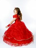 Cute Little Princess Dressed In Red Dancing. Isolated On White Background.