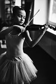 Little ballerina playing the violin