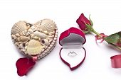 Red roses, an engagement ring and heart