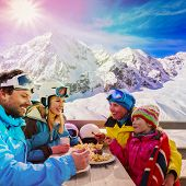 Winter, ski - skiers enjoying break for lunch, filtered