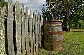 Wooden barrel near old fence