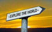 Explore the World sign with a sunset background