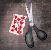 image of ten  - Concept of addiction card with scissors ten of hearts - JPG
