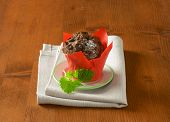 delicious dark chocolate muffin, served on the plate with fabric linen