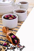 Black Tea With Rose Petals On White Background