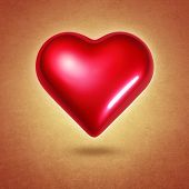Big red shining heart hovering over textured yellow background
