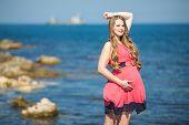 Pregnant woman on the beach.