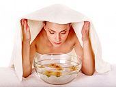 Facial massage with steam treatment.Towel on head