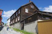 Tourists explore street of Roros in Roros, Norway.