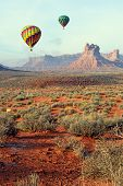 foto of bluff  - Colorful hot air balloons floating over the scenic desert of southeastern Utah in Valley of the Gods near the city of Bluff at sunrise. ** Note: Visible grain at 100%, best at smaller sizes - JPG