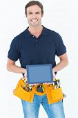 Portrait of happy carpenter holding digital tablet over white background
