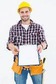 Portrait of happy male repairman showing clipboard over white background