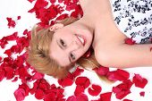 Beautiful Teen Girl Laying On Rose Petal Over White poster