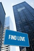 The word find love and blue billboard against low angle view of skyscrapers