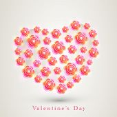 Creative heart shape made by beautiful flowers on grey background for Happy Valentines Day celebration.
