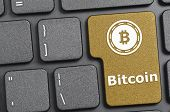 Golden bitcoin key on keyboard