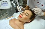 young woman during cosmetic body treatment