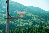 stock photo of inappropriate  - Security CCTV monitor inappropriate behavior in public area with mountain background - JPG