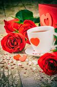 St Valentine's Setting With Coffee Cup And Red Roses