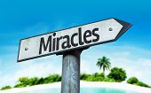 Miracles sign with a beach background