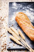 Freshly Baked French Baguette And Wheat
