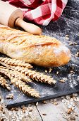 pic of baguette  - Freshly baked french baguette in rustic setting with wheat