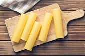 cannelloni pasta on cutting board