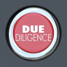 foto of merge  - Due Diligence words on a red car start or ignition button to illustrate the importance of researching the facts behind a company before you buy or merge with it - JPG