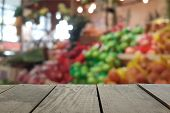 stock photo of supermarket  - Defocus and blur image of terrace wood and Supermarket blur background in Fruits and Vegetables devision for background usage - JPG