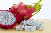 picture of dragon fruit  - dragon fruit slicing on chop block in white background - JPG