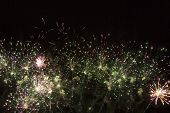 foto of salute  - great salute with green and pink fireworks - JPG