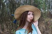 foto of windy  - Freckled happy girl in hat on windy day - JPG