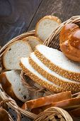 foto of fresh slice bread  - Handmade fresh sliced bread in a wicker basket - JPG