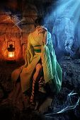 image of dungeon  - Beautiful crying princess in the dark dungeon with the spiders - JPG