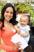 picture of mailbox  - Hispanic Mother And Baby Checking Mailbox - JPG