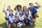 picture of trophy  - Group Of Children In Soccer Team Celebrating With Trophy - JPG