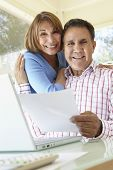 stock photo of hispanic  - Senior Hispanic Couple Working In Home Office - JPG