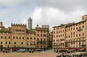stock photo of piazza  - Piazza del Campo is the principal public space of the historic center of Siena Tuscany Italy and is regarded as one of Europe - JPG