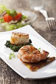 stock photo of hash  - closeup of a grilled shrimp on a hash brown