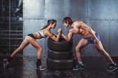 pic of angry man  - Athlete muscular sportsmen man and woman with hands clasped arm wrestling challenge between a young couple Crossfit fitness sport training lifestyle bodybuilding concept - JPG