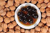 stock photo of walnut  - Top view of walnuts and jam from walnuts - JPG